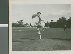 A Baseball Player from Ibaraki Christian College Pitching the Ball, Ibaraki, Japan, 1953