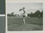 A Baseball Player from Ibaraki Christian College Pitching the Ball, Ibaraki, Japan, 1953