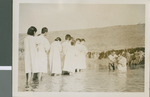 Baptizing twenty Koreans in the river, Seoul, Korea, 1954