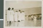 Baptizing twenty Koreans in the river, Seoul, Korea, 1954