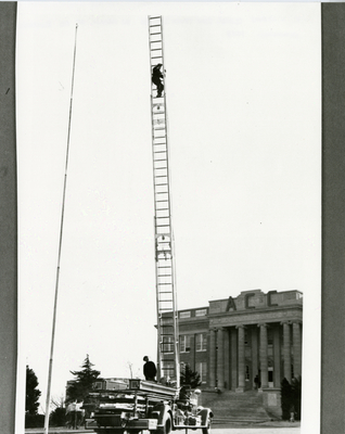 Fire truck with a man on a ladder